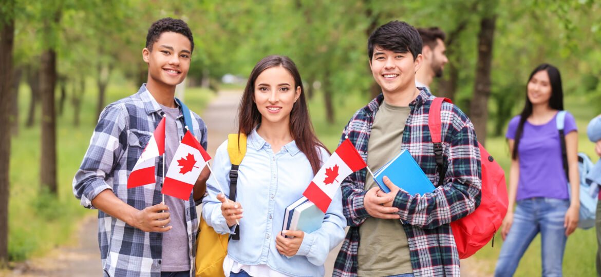Group,Of,Students,With,Canadian,Flags,Outdoors